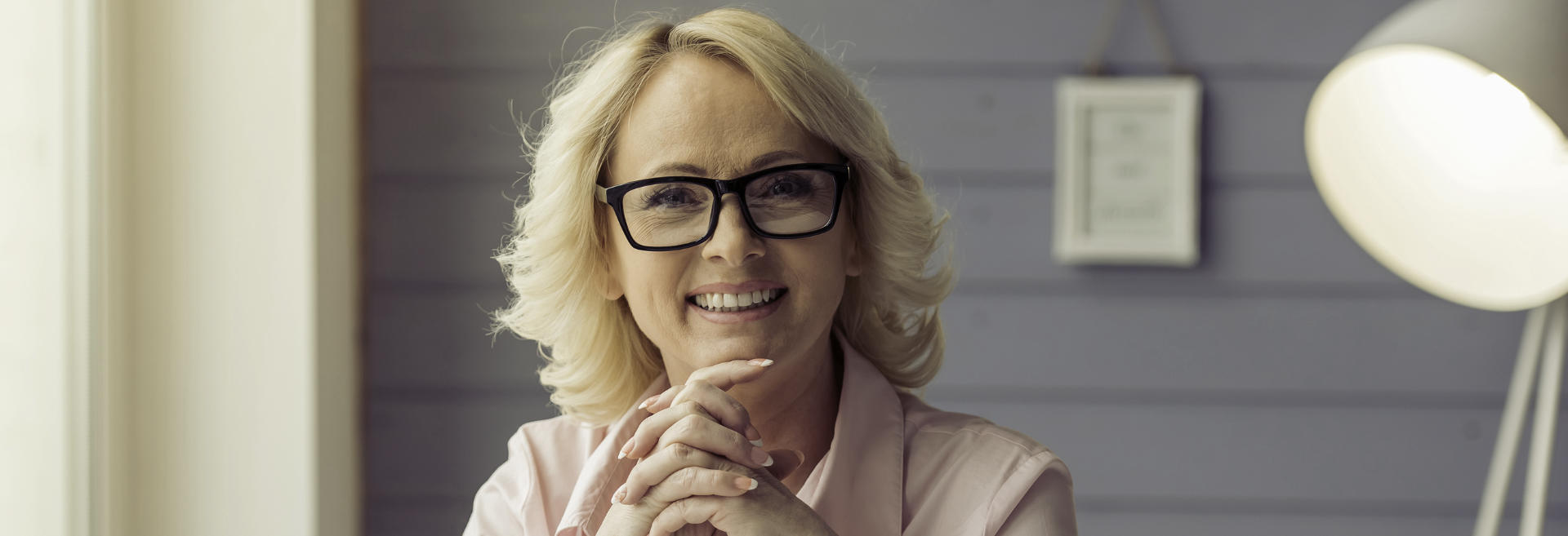 mature woman with glasses showing her beautiful teeth in a smile