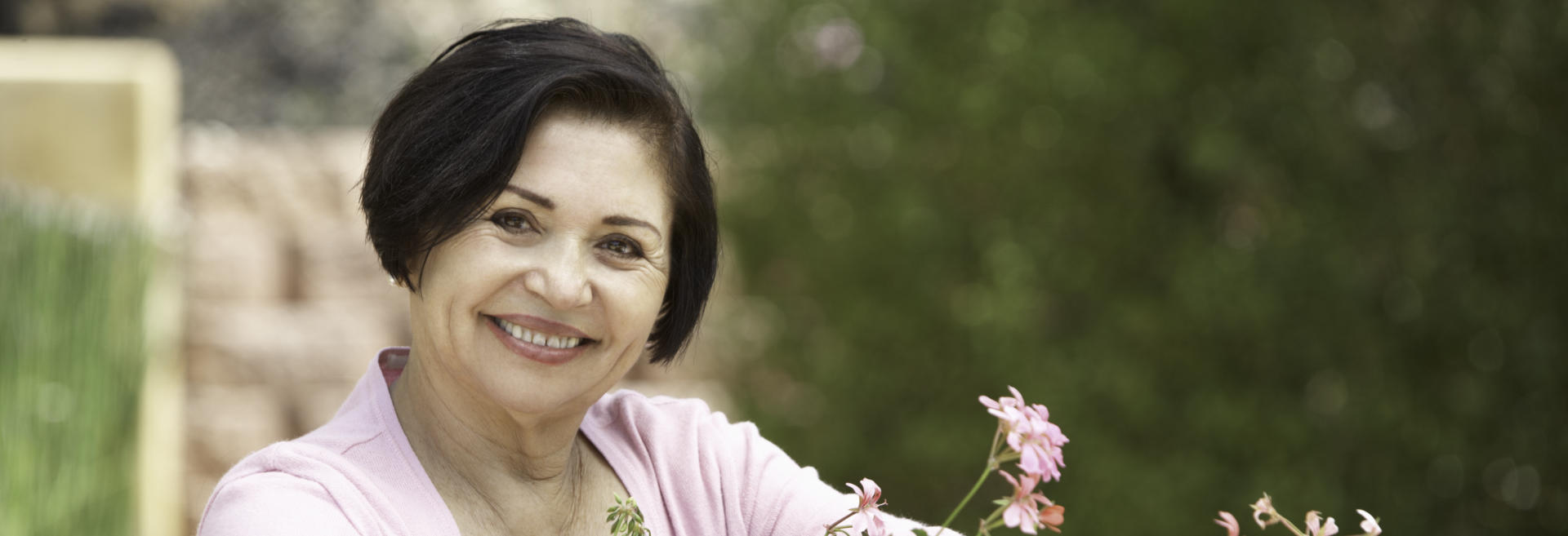 A happy senior woman showing her nice teeth after dental implant restoration in her smile.