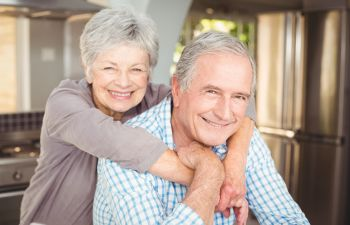 broadly smiling senior couple