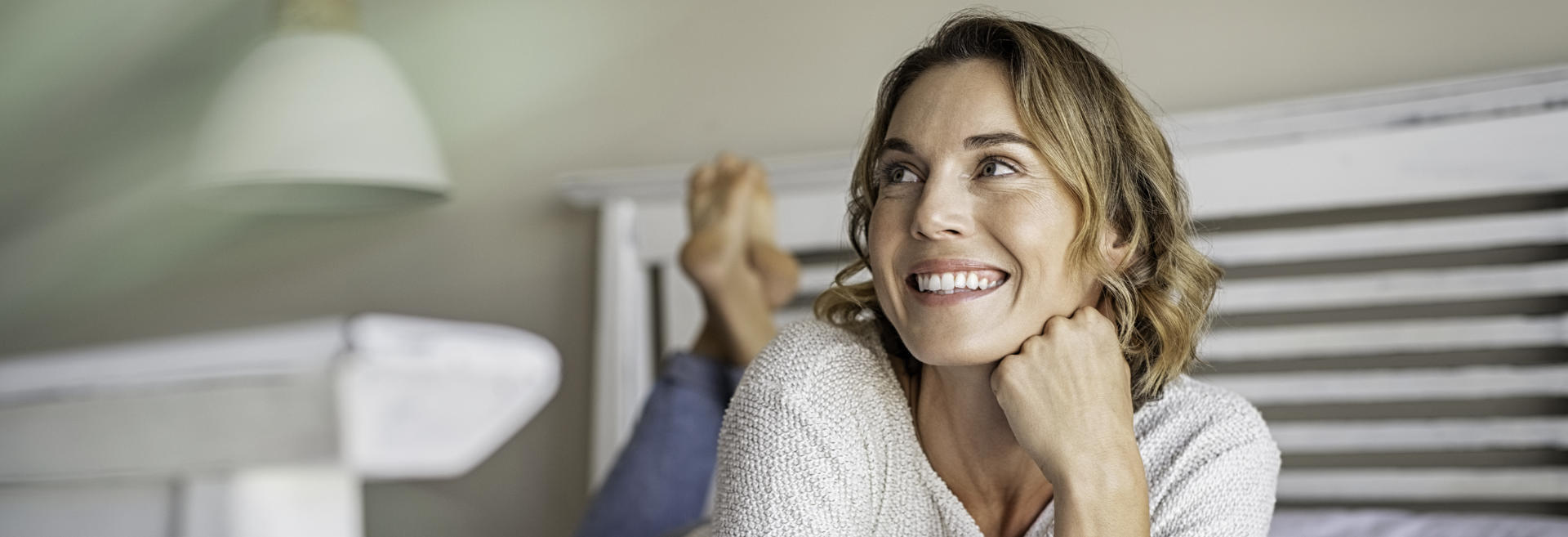 Relaxed middle-aged woman showing beautiful yeeth in her smile.